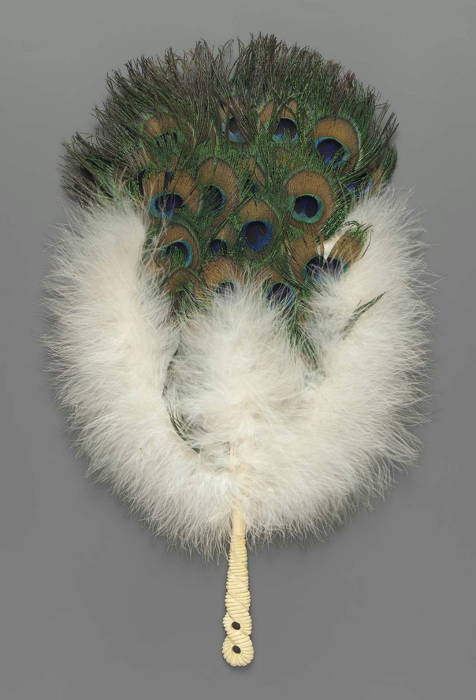 Rigid fan covered in green peacock feathers with a gold and blue,  surrounded on the lower half by white swan's-down. The … | Feather fan,  Antique fans, Vintage fans