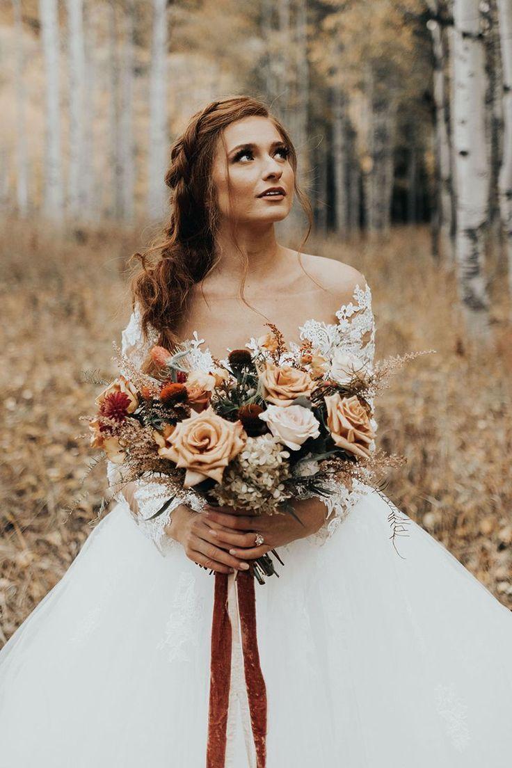 organically shaped bridal bouquet in warm terracotta