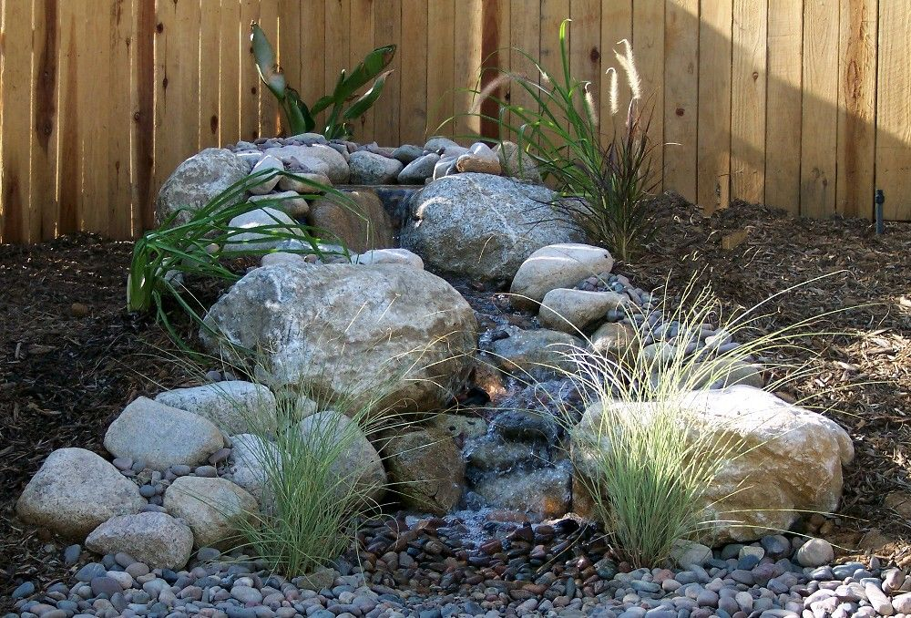 Small outdoor water feature designs water features for Small pond features