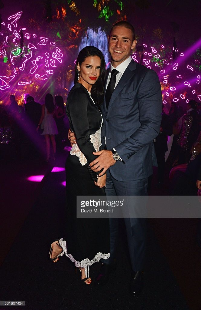 Adriana Lima (L) and Joe Indulge attend the Chopard Wild Party during the 69th Annual Cannes Film Festival at Port Canto on May 16, 2016 in Cannes.