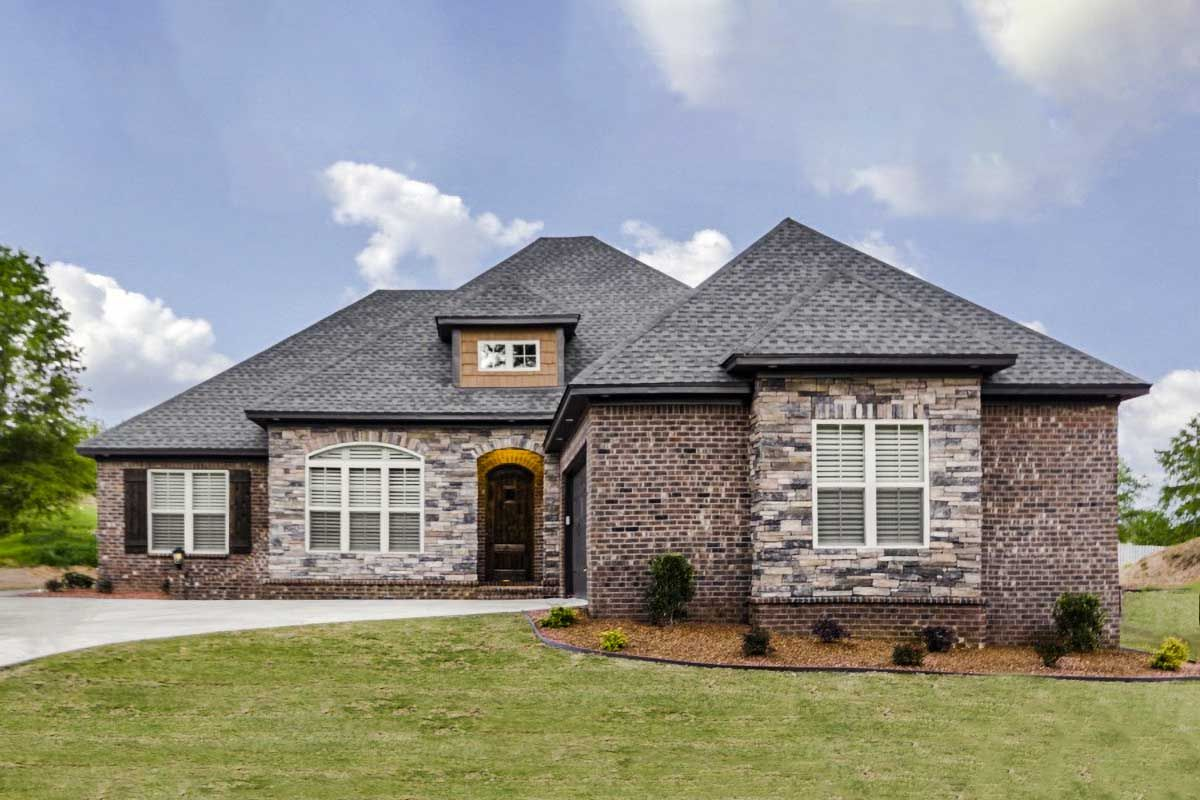 The Brick And Stone Facade Provide A Strong And Stunning Exterior On This New American Hou One Level House Plans Shingle House Architectural Design House Plans