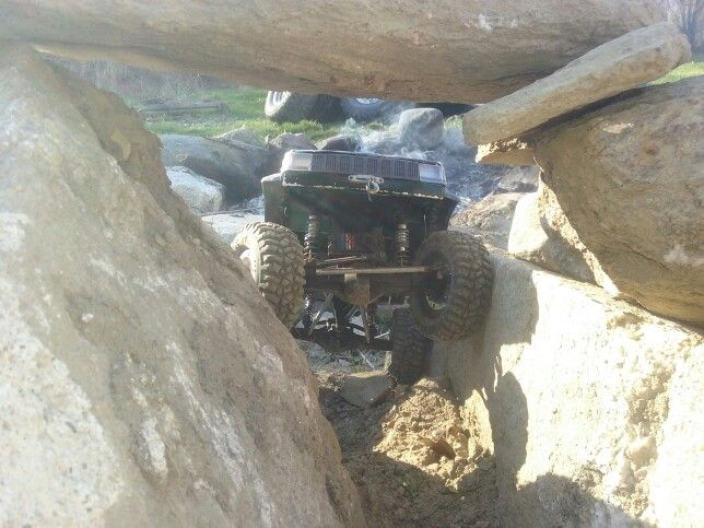 My hand made, all aluminum bodied R/C crawler. The ZJ-10 crawling into the tunnel in the rock obstacle I built today.