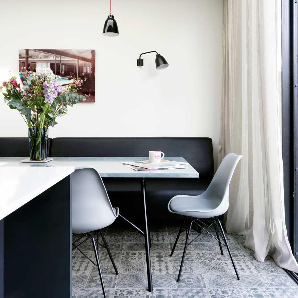 Monochrome kitchen diner with bench seat