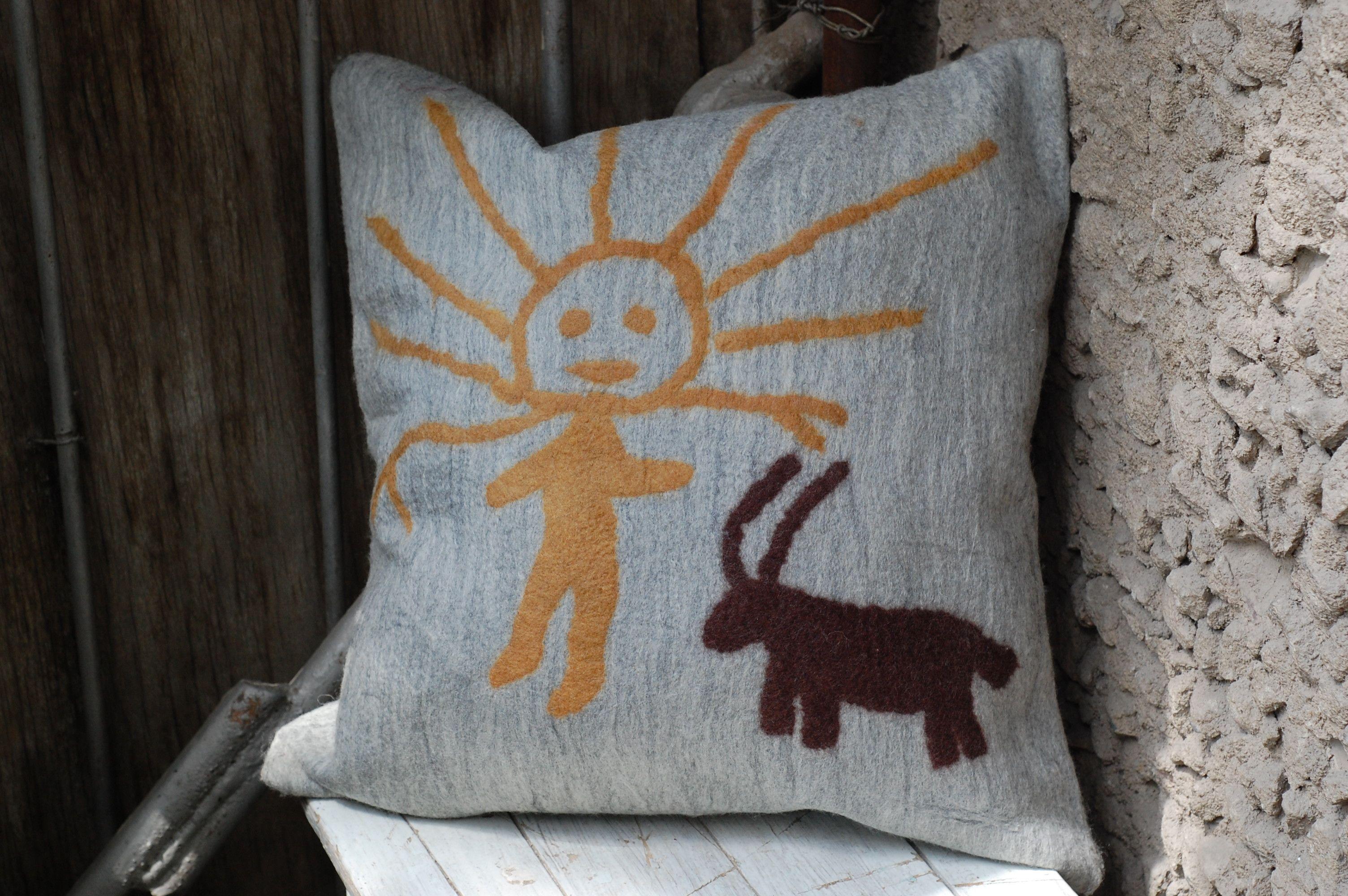 """Sun Boy"" - our cushion cover based on petroglyphs in Kyrgyzstan, made by Purity.    Handmade from felt, using the traditional Kyrgyz method ""Ala Kiyiz"" www.madeandtold.com"