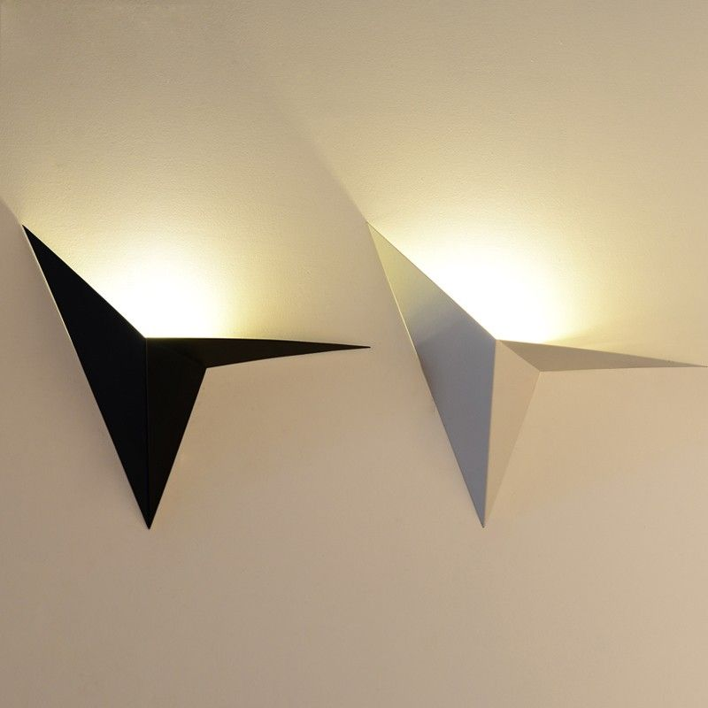 This geometric triangle uplight wall light in group configuration this geometric triangle uplight wall light in group configuration provides a fascinating factor or lights up mozeypictures Images