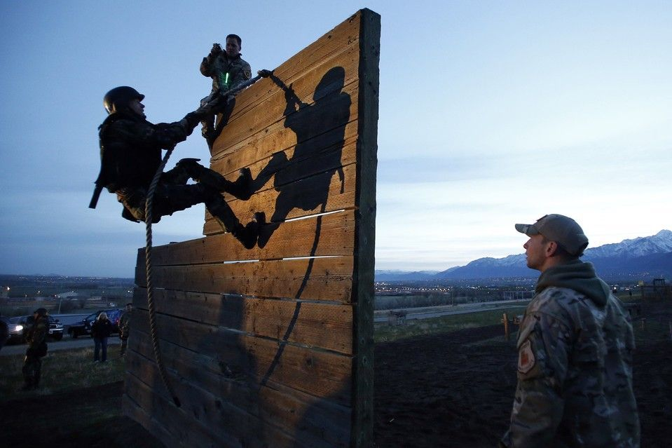 UP AND OVER: Candidates for law-enforcement agencies across Utah participated in the Salt Lake City...