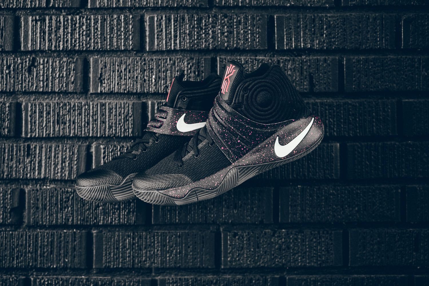 a1b5f794ab31 A Black Upper And Bright Crimson Speckling Highlight This Nike Kyrie ...