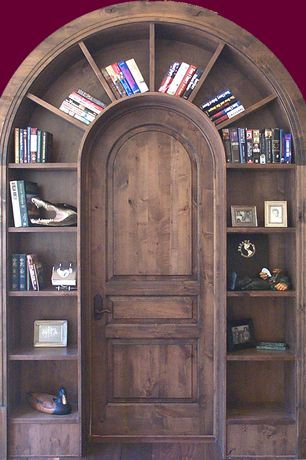 Southwestern Home Office With High Ceiling Specialty Door Built In Bookshelf Home Bookcase Door Home Library