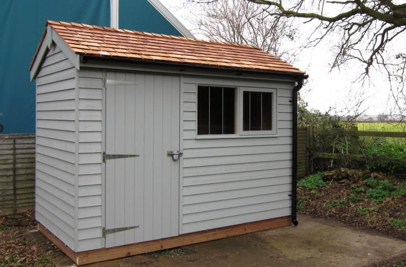 Superior garden shed with weatherboard cladding with a for Cedar shingle shed