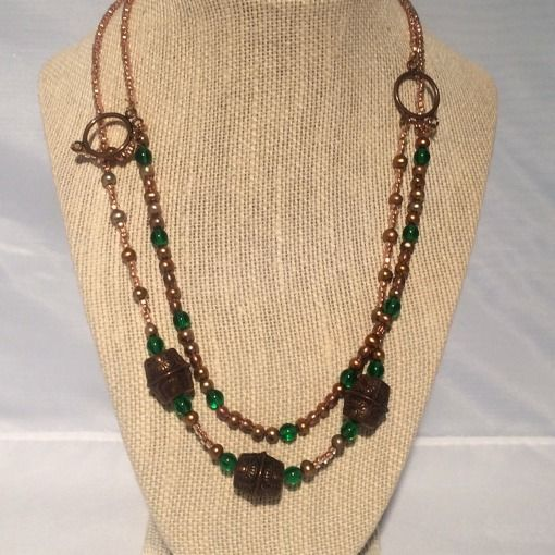 Brass and green bead necklace that was #handmade by an #immigrant from Iran. http://tembogroup.us/product/brass-beads-chain-necklace/