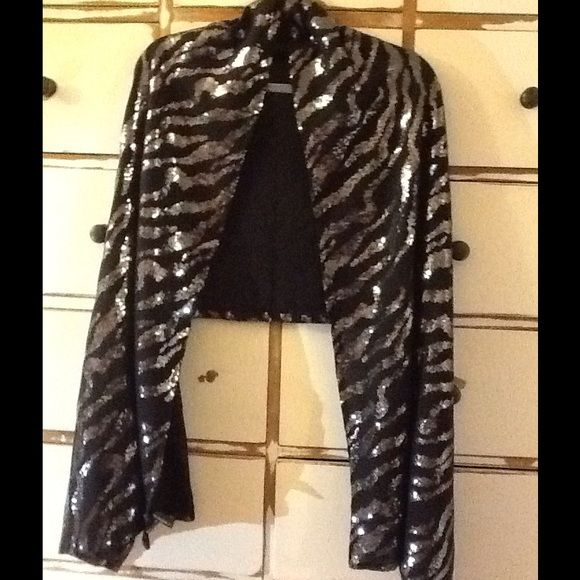 CYNTHIA ROWLEY SEQUIN WRAP FESTIVE SEQUINED WRAP CYNTHIA ROWLEY Perfect for that Holiday Get Together or  Special Occassion. NO LOOSE SEQUINS!  Has just a touch of Spandex in fabric to give it a beautiful drape.  PEACE Cynthia Rowley Accessories Scarves & Wraps