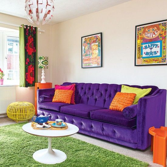 Colourful modern living room with purple sofa and green rug also