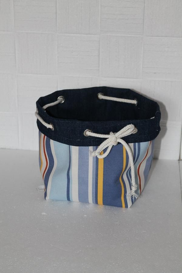 this item is sold but can use this picture for inspiration to make your own drawstring fabric basket that  can be turned inside out.
