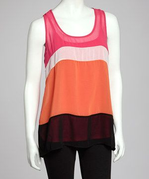 Bold bright colors combine to accent this captivating color block-inspired piece, while the sleeveless silhouette bares sun-kissed shoulders.
