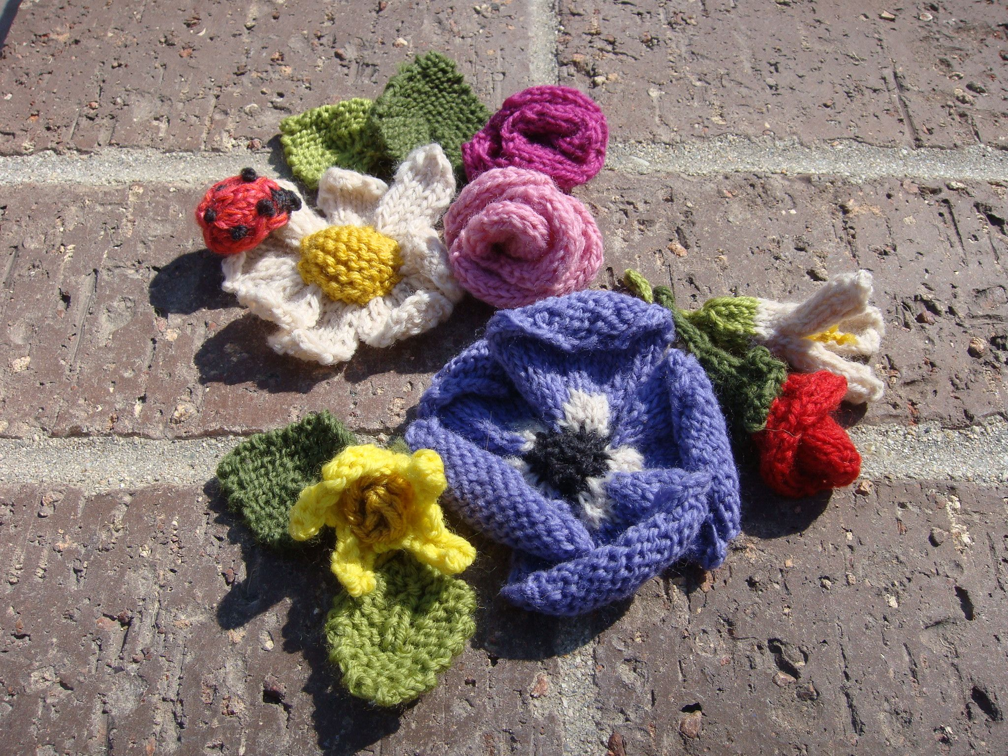"I found an amazing knitting book by Lesley Stanfield! Thom saw me knitting day & night, said ""What RU going to do w/ that?"" Well I had no idea then Keiko called me one day & told me she needed donation item for 3/11 Japan disaster fundraising event. I knitted 30 mini rose butts for wrapping decorations."
