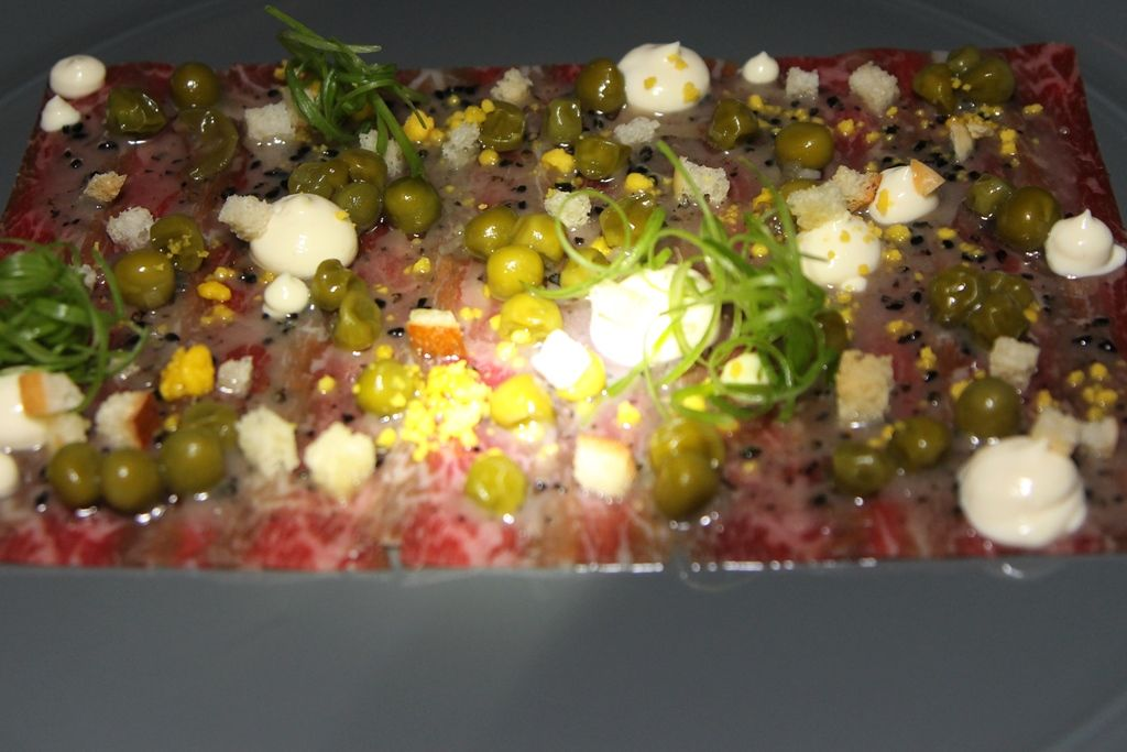 Omaw Restaurat Toronto - aged wagyu - beef fat vinaigrette, onion tops, pea relish, coffee $16