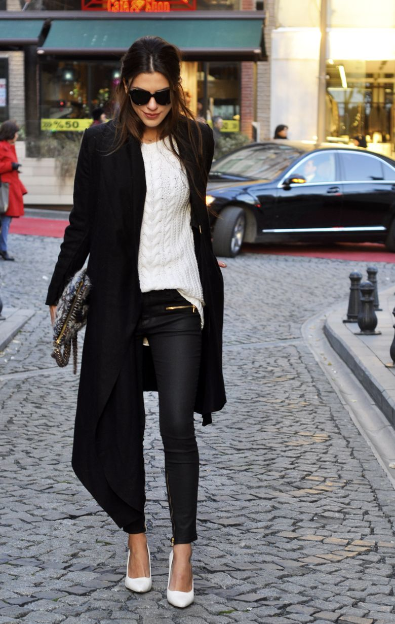 chicers. Love the longer coat length. Cabled sweater, ankle length waxed jean, snake clutch, and hearting the white pump.