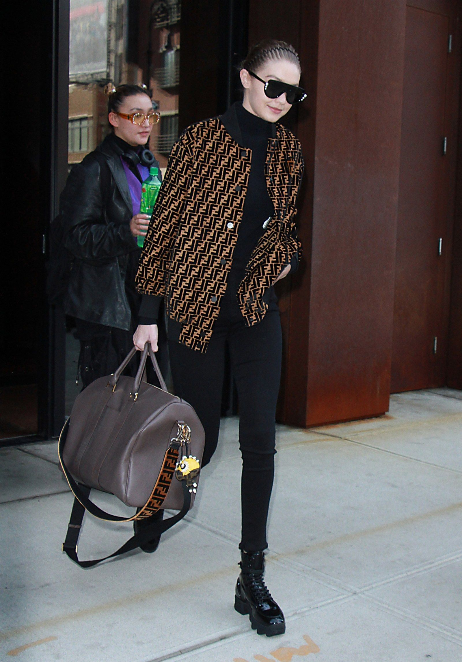 77a1ac4795c2 Vintage items that are worth the splurge! Seen here  Gigi Hadid in double F  Fendi logo jacket at the airport.