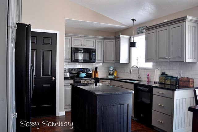 Love this kitchten grey, black with a bit of teal and pink Kitchen