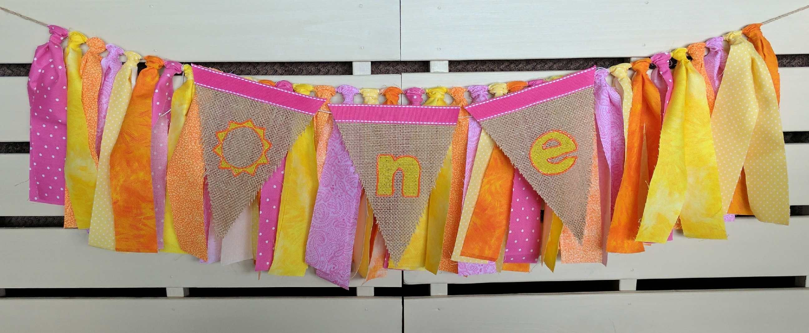 Bright pinks oranges and yellow fabric and burlap one banner by