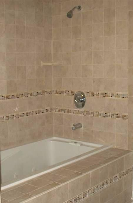 Love the deep, jetted soaking tub with tile surround! The glass tile ...