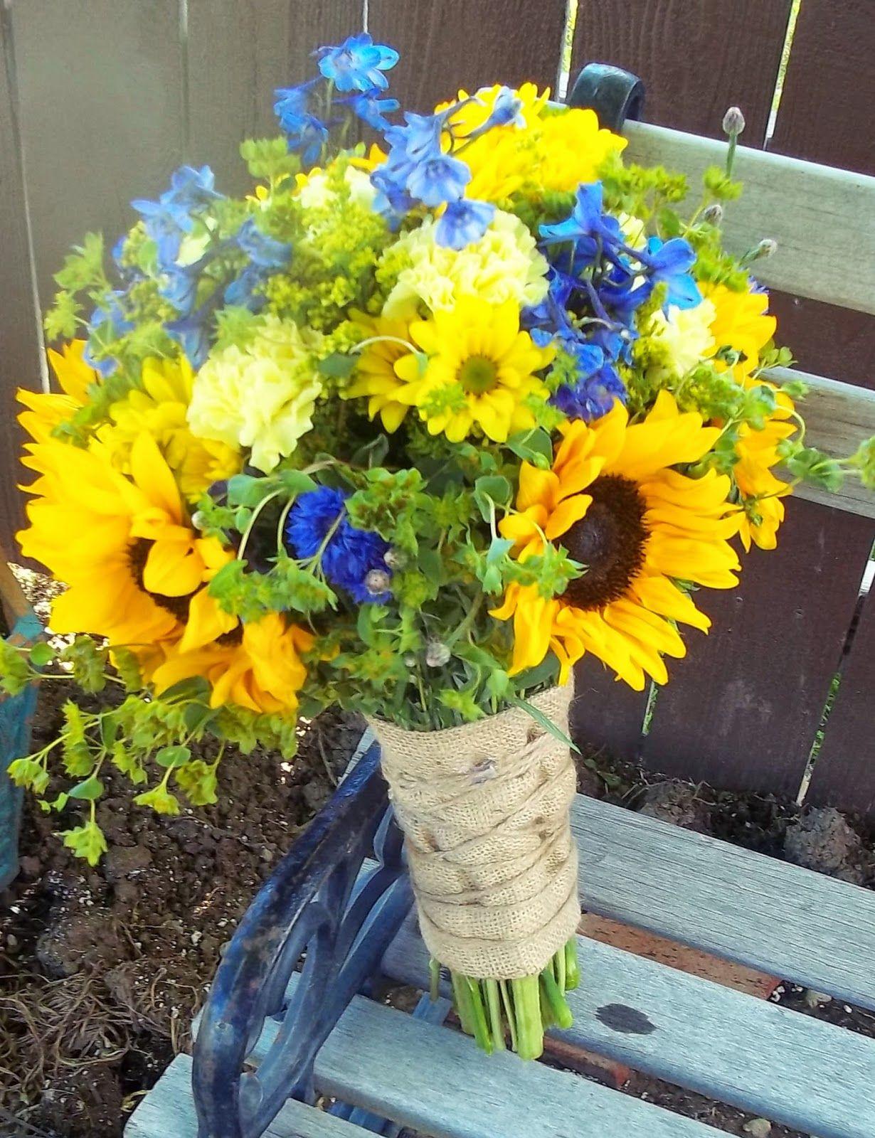 yellow and navy wedding, sunflowers, blue delphinium DF