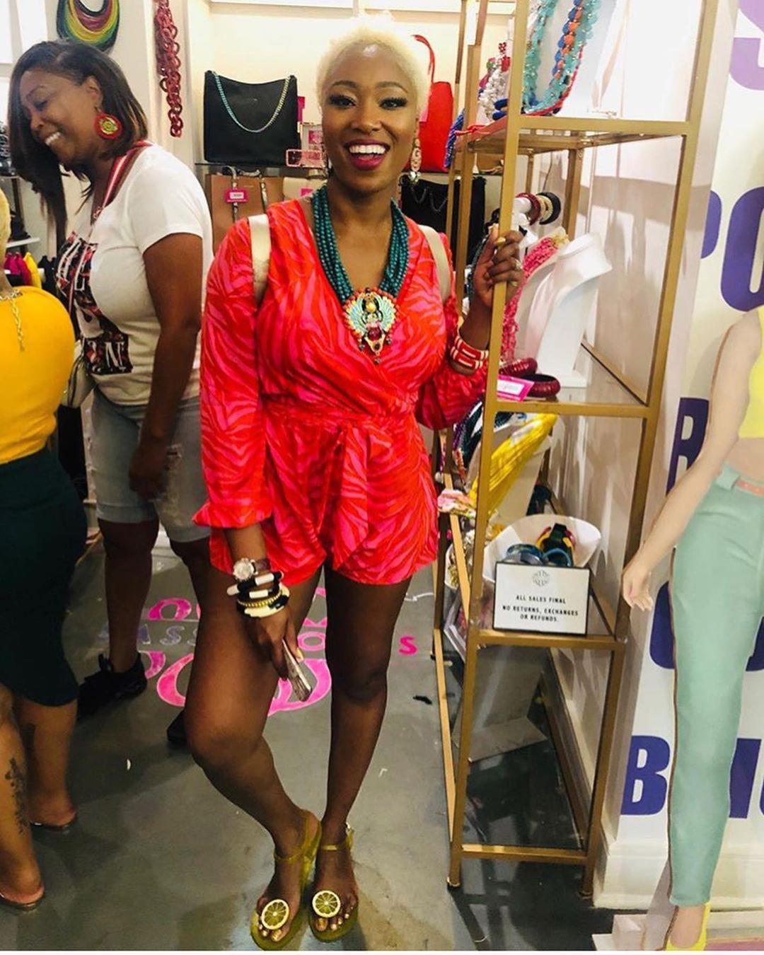 Izzy & Liv Pop Up Shop with gold shelving during Essence Fest in New Orleans #essence #essencefest #essencefestival #essenceneworleans #shelving #brandactivation