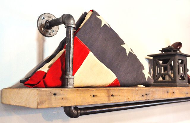 Simple Pipe Shelves: Pipe shelf with reclaimed wood displaying an American flag