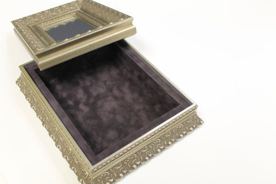 Jewlery box by Colbert Framing on Etsy, $145.00 . Ornate Silver Jewlery box with suede liner .