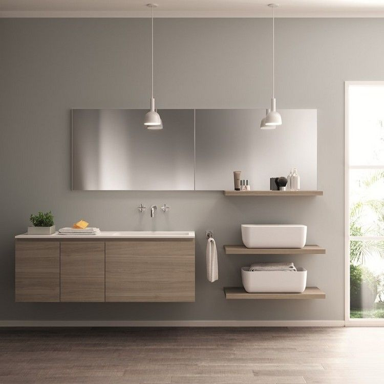 Cuisine intégrée et salle de bain épurée de design italien par