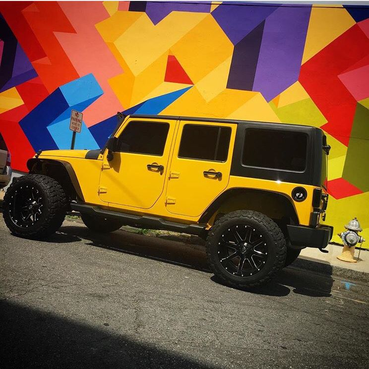 Yellow 4 Door Jeep Jk With Great Looking Wheels Yellow Jeep