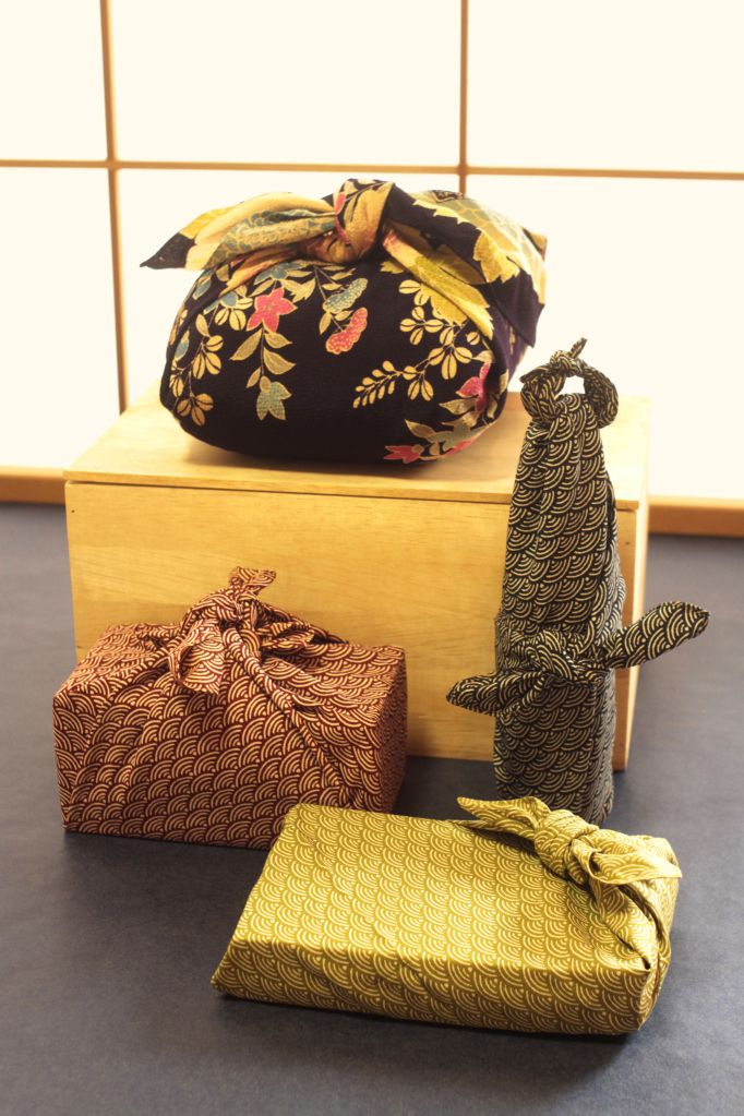 Furoshiki, japanese fabric wrapping. I actually have done this with tea towels before, but these look amazing!