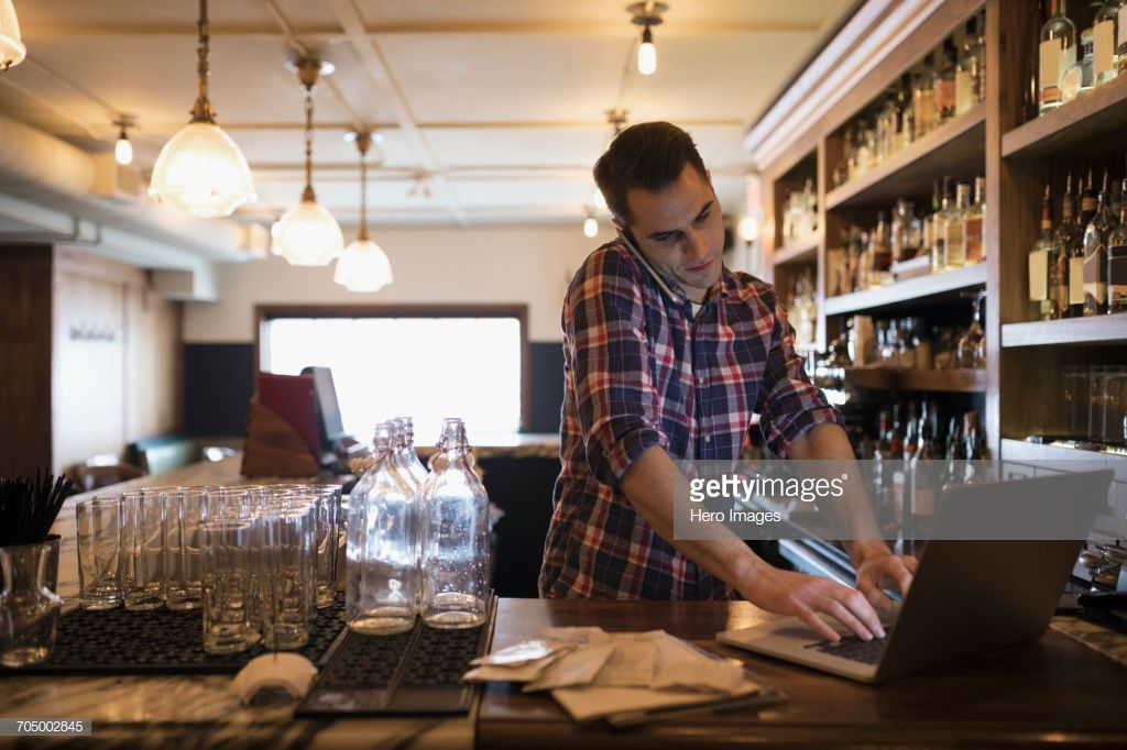 Stock Photo Male business owner talking on cell phone