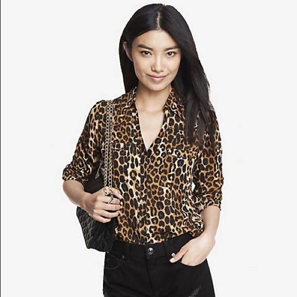 Original Fit Leopard Print Portofino Shirt A classic in the making, the Portofino shirt merges an effortlessly sexy semi-sheer look with amazingly easy care. In our signature leopard print, it projects power at the office with a pencil skirt, and finds a playful, kittenish vibe over denim.  Original fit Point collar, notch neckline, button front Long convertible sleeves with roll tabs Patch breast pockets, shirttail hem, semi-sheer crepe Polyester Machine wash Imported Express Tops Button…