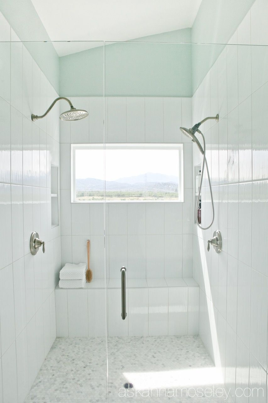 Master bathroom shower with dual shower heads and a panoramic window ...