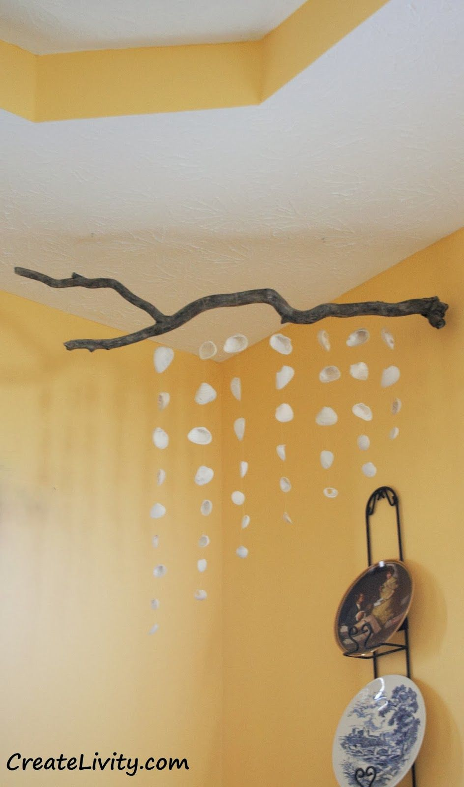 Hang seashells from driftwood branch. Similar to this: http://www ...