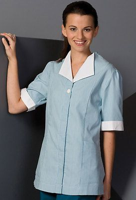 Ed Garments Women's Button Closure Short Sleeve Housekeeping Tunic. 7275 Description  75% Polyester/25% Cotton; 4.4 oz.wt. Short sleeve housekeeping tunic, Hidden placket, button closure, Contrasting collar/cuff and two front pockets, Back pleat and side slits for easy movement, Laundry friendly.