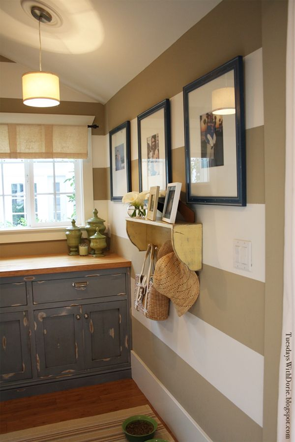 Room Inspiration – Tuesday's With Dorie | The Lettered Cottage  Gray distressed cabinet.  Love the walls, the shelf, the cabinet and the way the photos are framed.