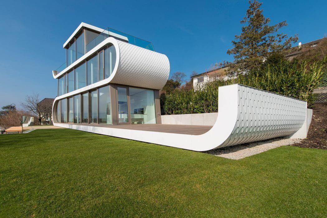 Flexhouse in switzerland resembles a futuristic vessel for Modernes haus zurich