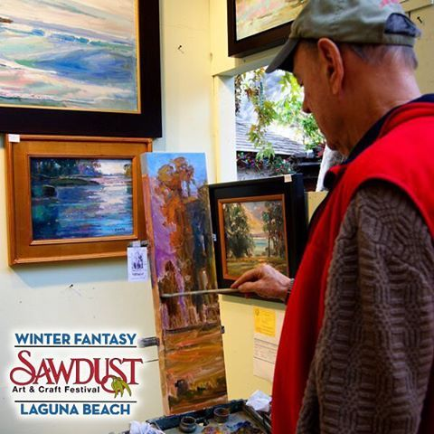 "‪#‎MotivationMonday ""If you hear a voice within you say 'you cannot paint' then by all means paint, and that voice will be silenced."" ~Vincent Van Gogh Photograph featuring Sawdust artist John Eagle and his artwork.‪ #WinterFantasy #SawdustArtFestival"