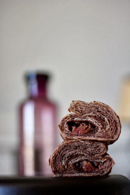 chocolate and cardamom croissants with chocolate ganache and poached plums. — Engrained