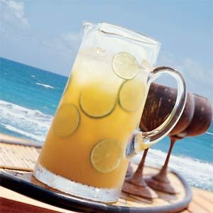 Ultimate Rum Punch...all I saw--coconut rum. I am sold! Summertime just became refreshing!