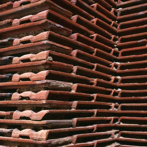 Stacks Of Reclaimed Roof Tiles Form Walls Inside This Former Slaughterhouse In Madrid By Spanish Architect Arturo Franco Roof Tiles Architecture Brick Detail