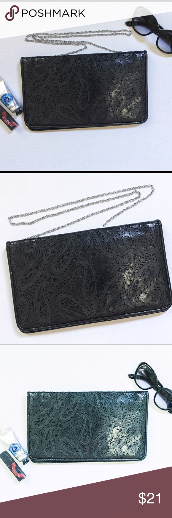 Laser Cut Pattern Black Crossbody Clutch Fabulous faux leather crossbody clutch bag with beautiful laser cut paisley pattern from Miztique! The silver chain strap is removable, so you can go between a clutch and a crossbody! EUC clean inside and out! 10% of proceeds go to a local nonprofit organization! Miztique for Target Bags Crossbody Bags