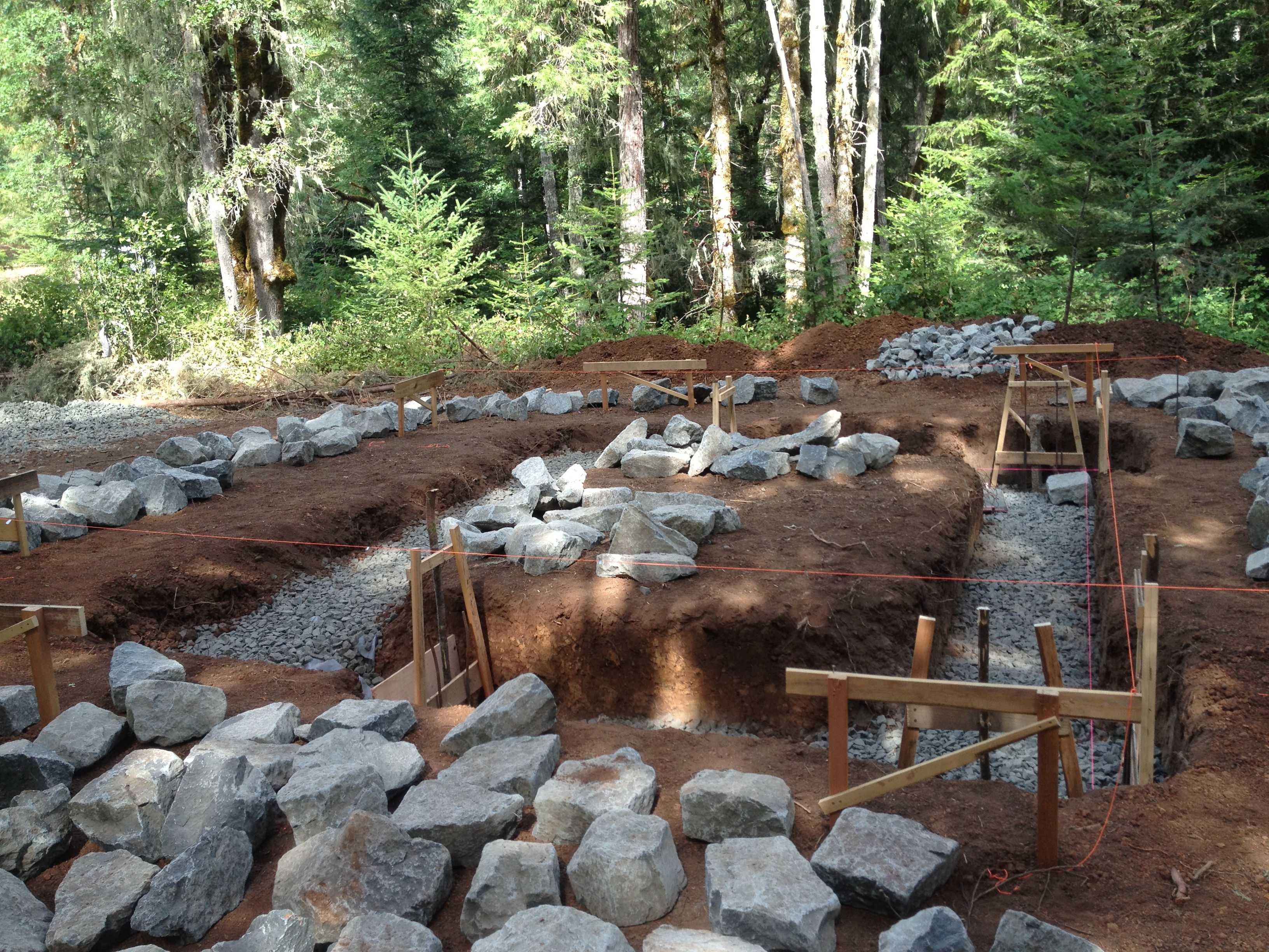 How to do a stacked stone foundation construction for Cordwood house cost