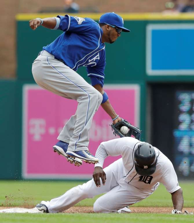 Detroit Tigers' Justin Upton avoids the tag of Kansas City Royals shortstop Alcides Escobar to steal second during the fourth inning on Sunday in Detroit. The Tigers won 4-2.