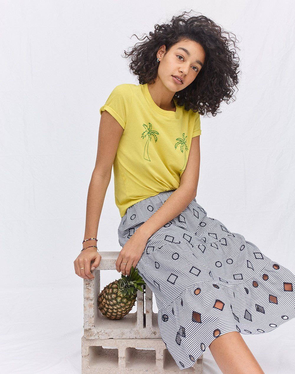 90658bf1977 madewell embroidered stripe midi skirt worn with embroidered palm radio  boxy tee + beaded hoop earrings.