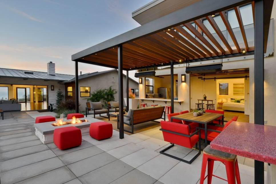 The Kitchen And Living Room Of House Flow Naturally Into This Modern Patio Design By Hauck Architecture That Adds Visual Flair With A Pergola