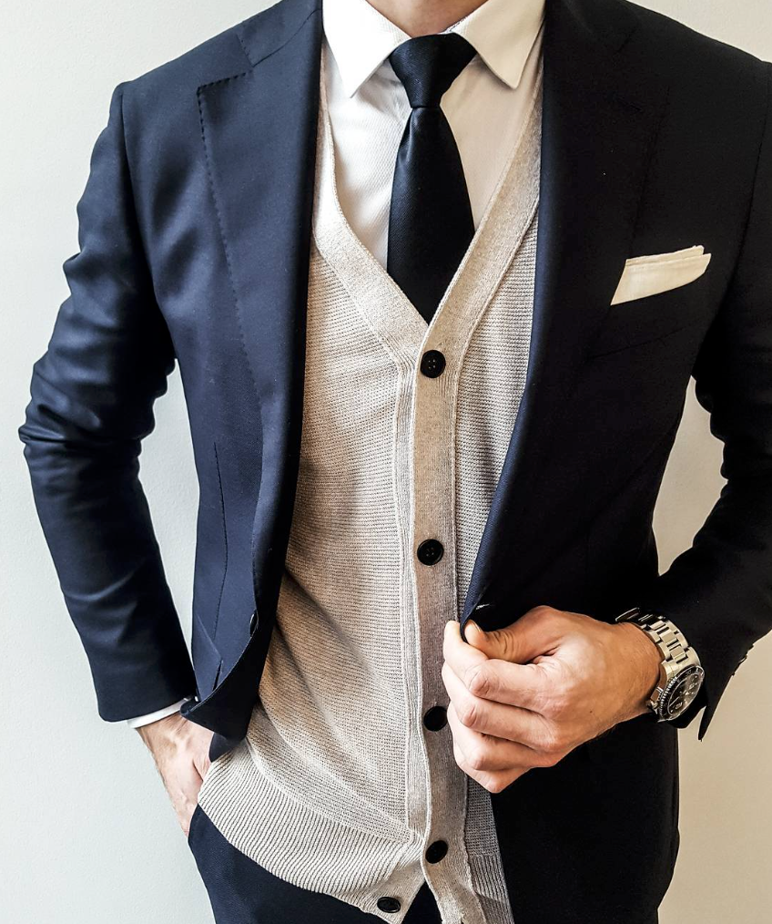 Designer style in a suit and cardigan with classic accessories ...