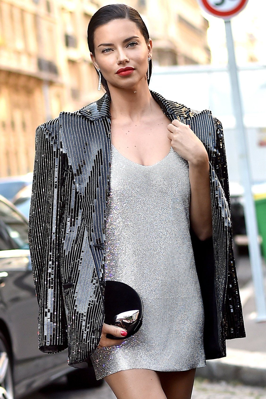Adriana Lima in a silver minidress in a sequin blazer - click through to  see more photos from fall 2018 Couture Week! cd869661b